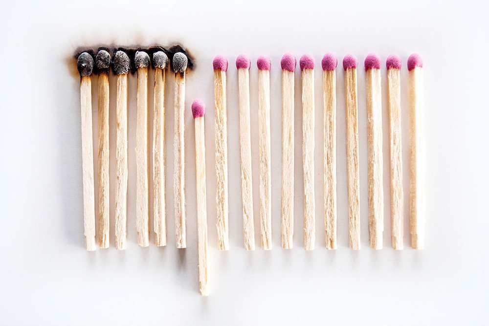 Burnt matches symbolizing COVID-19 social distancing