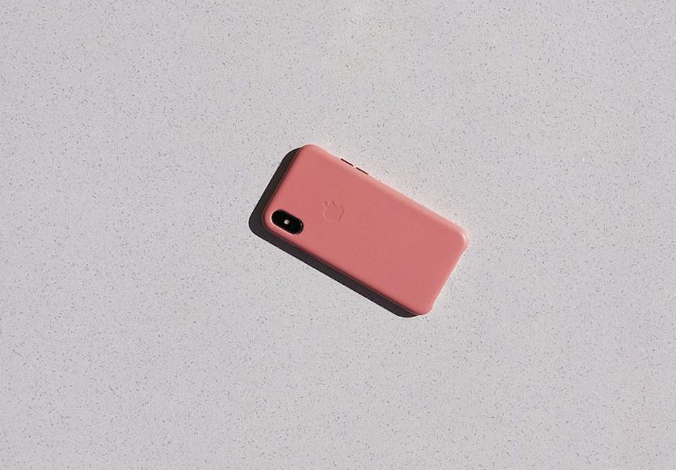 Pink iPhone representing a common place where cyber crime can occue